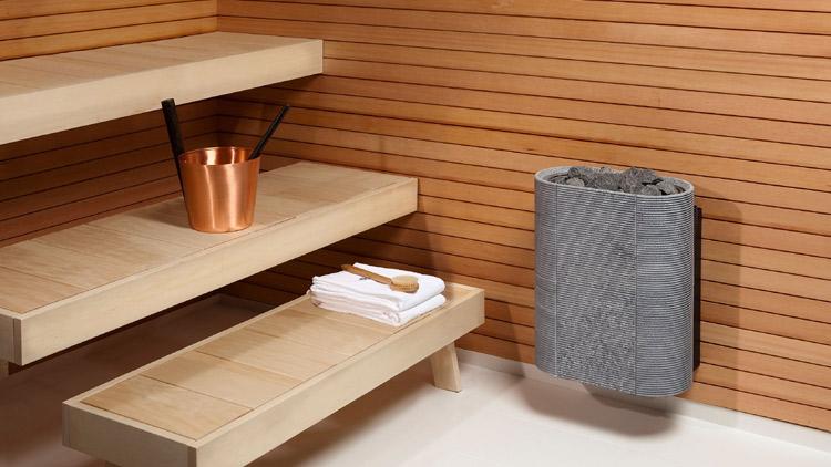 Tulikiven ensimmäinen seinäkiuas, Routa, jonka oivaltava muotoilu säästää tilaa saunassa.